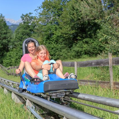 A mother and daughter enjoying a speedy descent on the Alpine Coaster!  | © Hinterramskogler